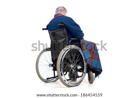 Lonely elderly in a wheelchair - stock photo