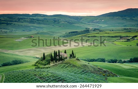 Lonely farmhouse, beautiful natural landscape at sunset. Tuscany, Italy