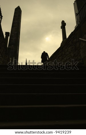 Lonely figure in Calton graveyard.