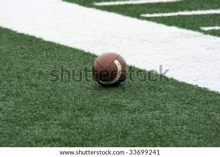 lonely football on the sidelines - stock photo