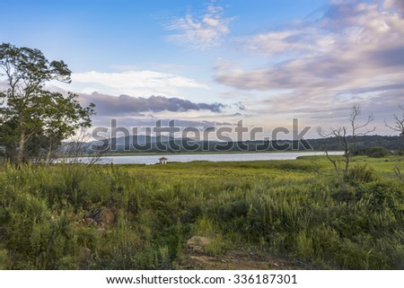 Lonely gazebo on the lake. Lonely gazebo on the lake, south of the Russian Far East. - stock photo