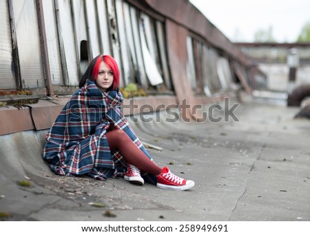 Lonely girl emo blanket wrapped herself on the roof - stock photo