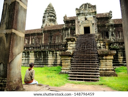 Lonely Girl in Angkor Wat Temple, Cambodia  - stock photo