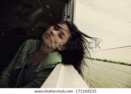 lonely girl rides on the train - stock photo