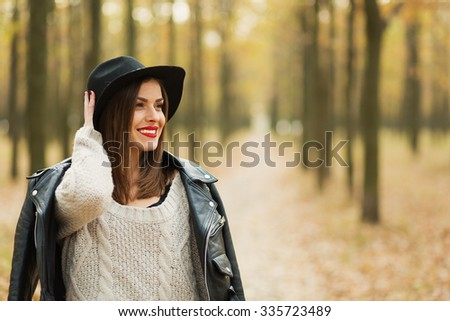 Lonely girl walking in the autumn park