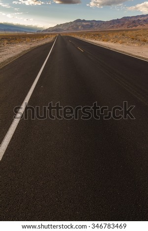 Lonely highway in the desert of California, USA - stock photo