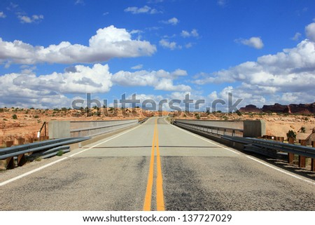 Lonely highway in the southern Utah desert, USA. - stock photo