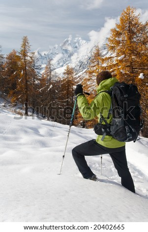 Lonely hiker looking at the wild landscape of Mont Blanc, Italy. - stock photo