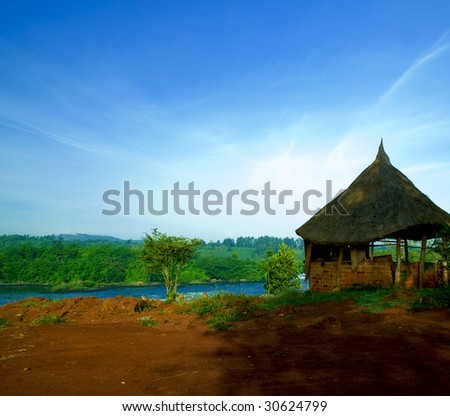 lonely hut on the shore of the Nile river - stock photo