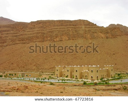 Lonely Kasbah in Morocco by the way  to mountains - stock photo