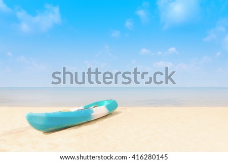 Lonely kayak boat on a tropical beach, Thailand. - (Summer, Travel, Vacation and Holiday concept) - stock photo