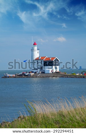 lonely lighthouse stands on the spit in the sea near the village of Marken. Near Amsterdam - stock photo