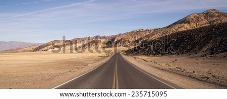 Lonely Long Highway Badwater Basin Death Valley - stock photo