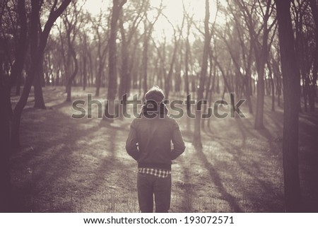 Lonely man in a forest  - stock photo