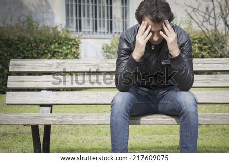 lonely man in the urban park - stock photo