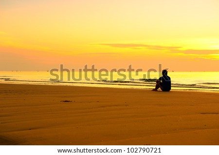 Lonely Man on Beach at Sunrise
