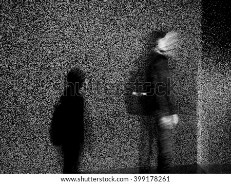 Lonely man on the side of the wall , black and white image with noise