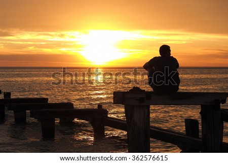 Lonely man watching the sunset at Port Philip Bay, Melbourne 2015