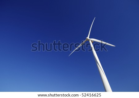 lonely modern windmill with blue and clear sky - stock photo