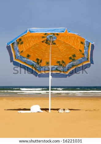 Lonely parasol on the beach