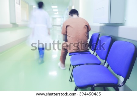 Lonely patient in hospital corridor. - stock photo