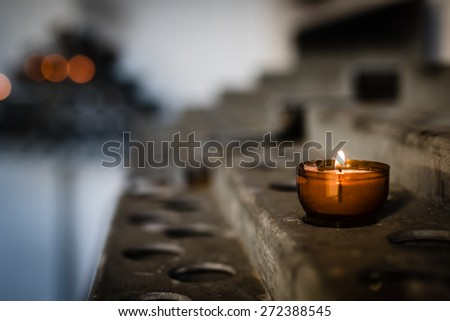 Lonely prayer candle. Selective focus. - stock photo