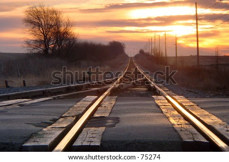 Lonely railroad crossing on cold winter morning - stock photo