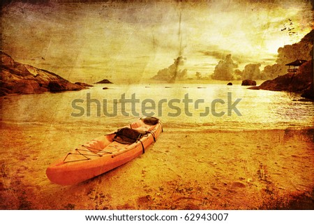 Lonely red kayak at the tropical beach in grunge and retro style . Kingdom Thailand - stock photo