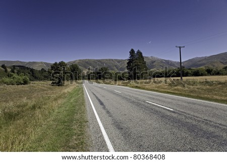 lonely road in rural area - stock photo