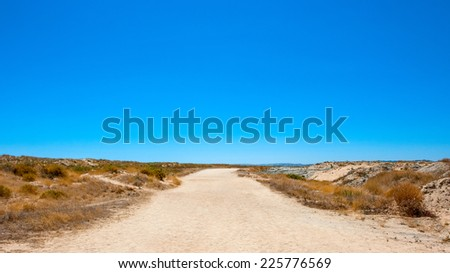 Lonely Road in the Desert , Portugal - stock photo