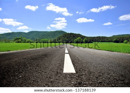 lonely road that leads to an infinite place on the horizon