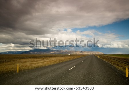 lonely road to eyjafjallajokull glacier and erupting volcano in iceland - stock photo