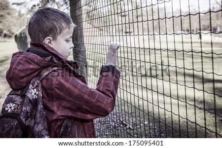 lonely sad kid after school. Alone, bullied - stock photo