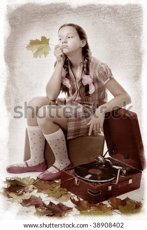 Lonely sad kid waiting sitting with gold fall leaf and gramophone,isolated on white - stock photo