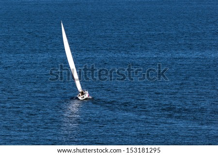 Lonely sailboat in the Baltic Sea. - stock photo