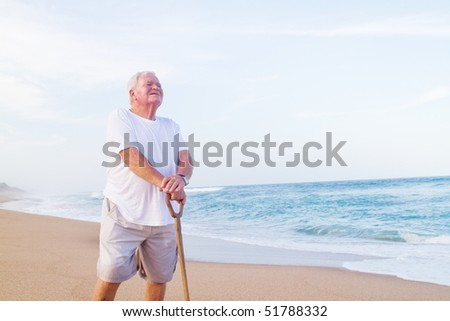 lonely senior man on beach - stock photo