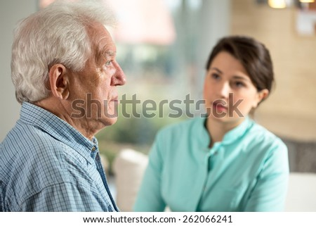 Lonely senior man staying in retirement home - stock photo