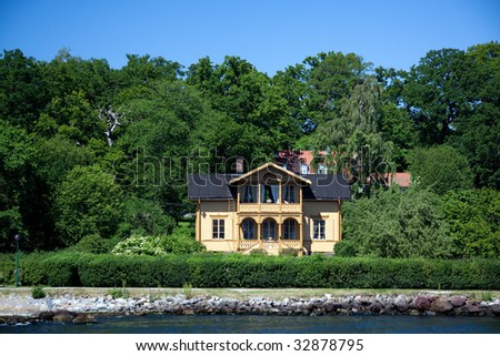 Lonely suburban House on the little island in Sweden,Stockholm Archipelago - stock photo