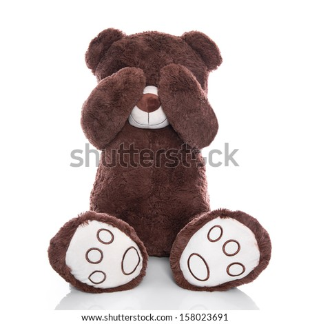 Lonely teddy bear covering eyes isolated on white background - sadness or problems concept - stock photo