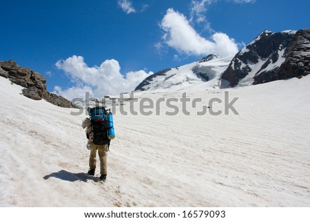 lonely tourist traveling in high mountains