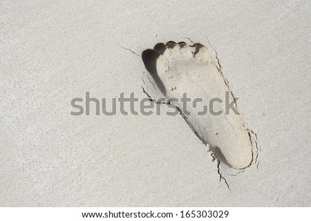 Lonely trace from a bare foot on sand. - stock photo