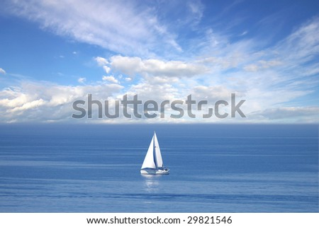 Lonely white sail at infinite ocean - stock photo