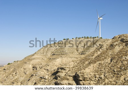 lonely windmill in a hill - stock photo