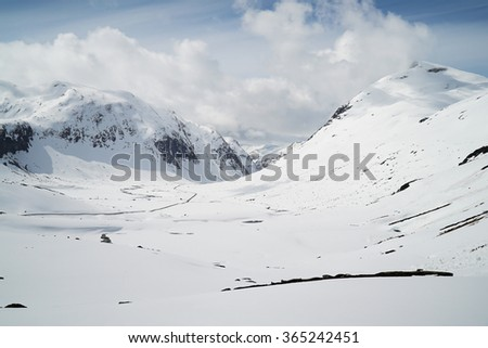 Lonely winter road - stock photo