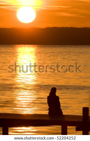 lonely woman at a lake