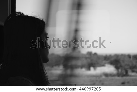 Lonely woman traveling with train - stock photo