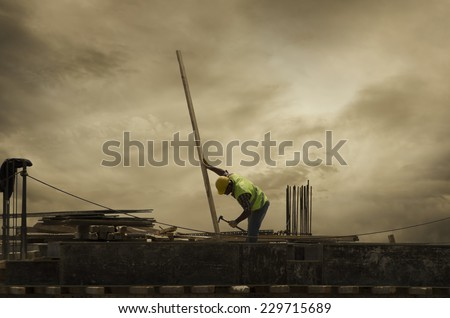 Lonely Worker and Construction - stock photo