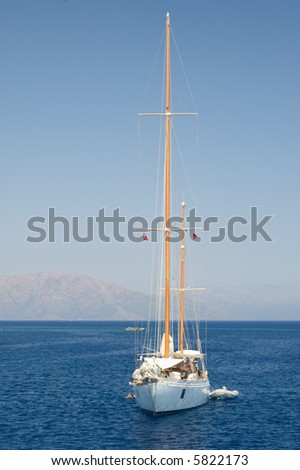 Lonely yacht against seascape background - stock photo