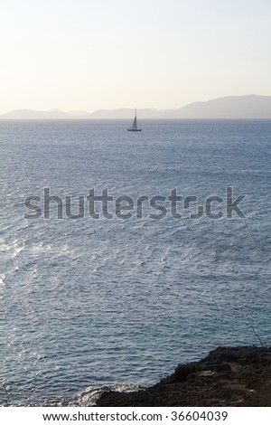 Lonely yacht at sunset in Majorca