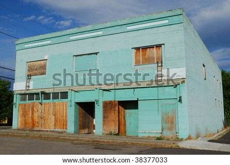 Long abandoned boarded up building - stock photo